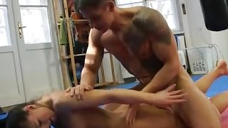 Hot brunette gets dominated and fucked by guy in wrestling match
